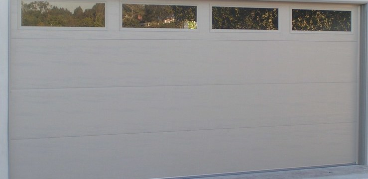 Garage door photo gallery denkers garage doors for 16x7 garage door with windows